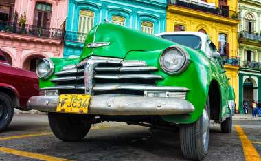 Old Chevrolet in front of colorful buildings November 282012 in Havana 120414844