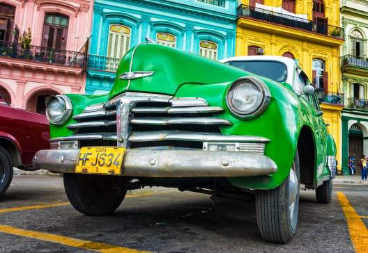 Old Chevrolet in front of colorful buildings November 282012 in Havana 120414844