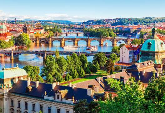 Old-Town-pier-architecture-and-Charles-Bridge-over-Vltava-river-in-Prague