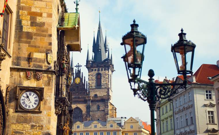 View-on-old-beautiful-historical-buildings-in-Prague-with-clock