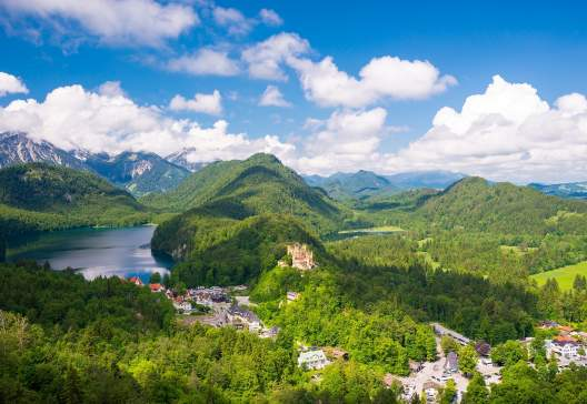 Castle-Hohenschwangau-eternal-forest-with-blue-mountains-and-lakes-of-Bavaria-Germany