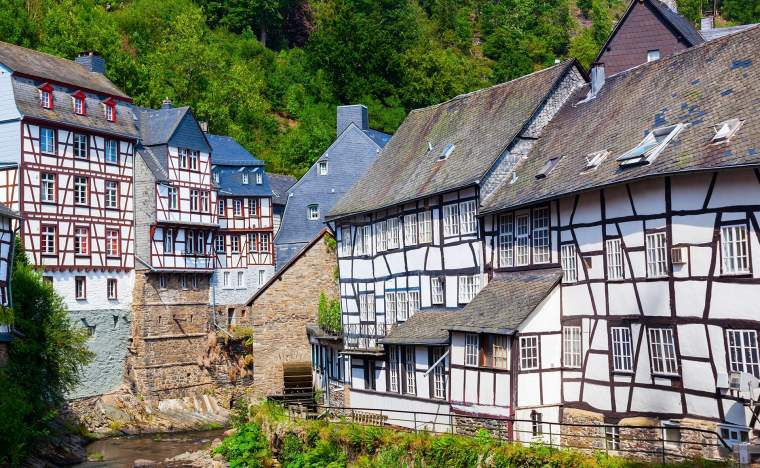 Old-half-timbered-houses-at-the-river-Rur-in-the-picturesque-Eifel-town-Monschau-in-Western-Germany