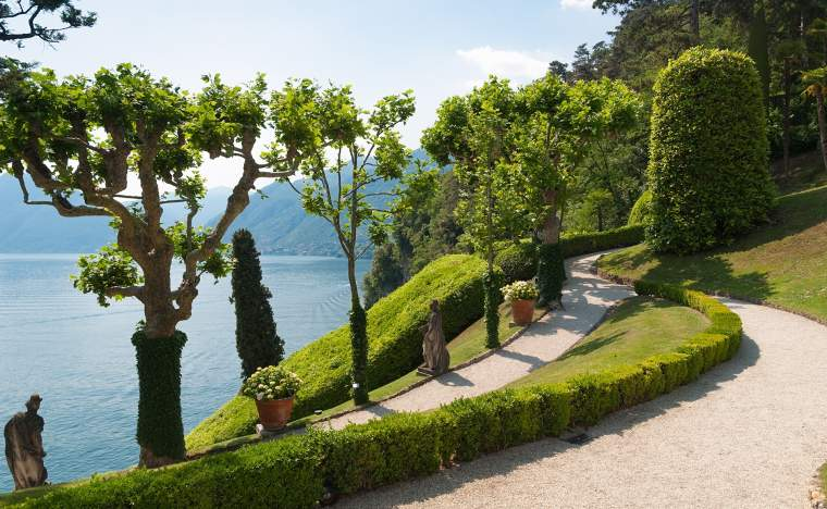 Tranquil-winding-path-in-the-Villa-Balbianello-garden-along-the-shore-of-lake-Como-Italy