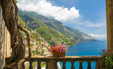 Positano-from-antique-terrace-with-flowers-Amalfi-coast-Italy.-balcony-with-flowers