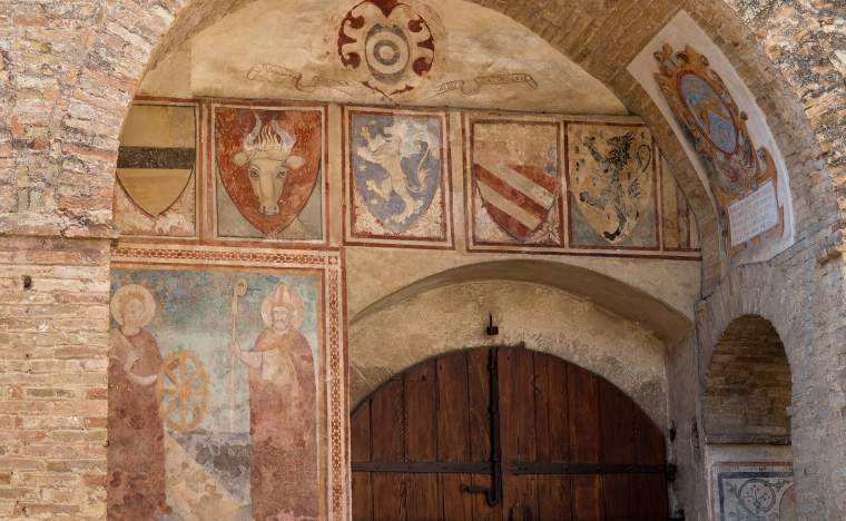 Old-frescoes-on-a-walls-in-the-town-hall-of-San-Gimignano