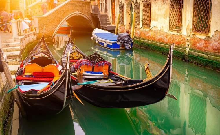 Canal-with-two-gondolas-in-Venice-Italy