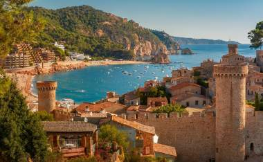 Aerial view of Fortress Vila Vella and Badia de Tossa bay at summer in Tossa de Mar