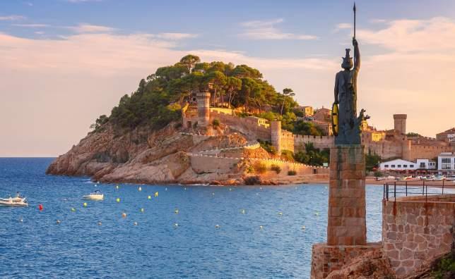 Statue of Minerva Fortress and Badia de Tossa bay in Tossa de Mar on Costa Brava