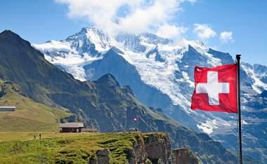 Swiss-flag-on-the-top-of-Mannlichen-Jungfrau-region-Bern-Switzerland