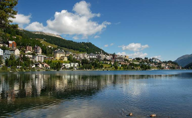 Cityscape of Saint Moritz with lake blue sky and clouds Engadin Switzerland Europe