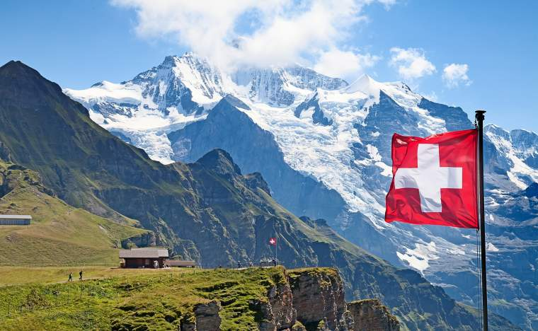 Swiss-flag-on-the-top-of-Mannlichen-Jungfrau-region-Bern-Switzerland