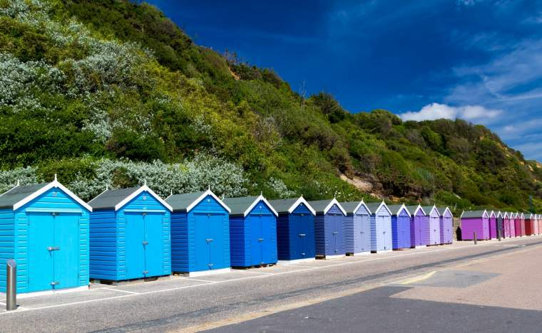 Colourful-wooden-beach-huts-at-Bournemouth-on-the-South-Coast-of-England