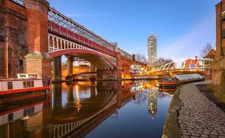 View of Manchester tallest building Beetham Tower reflecting in Manchester Canal