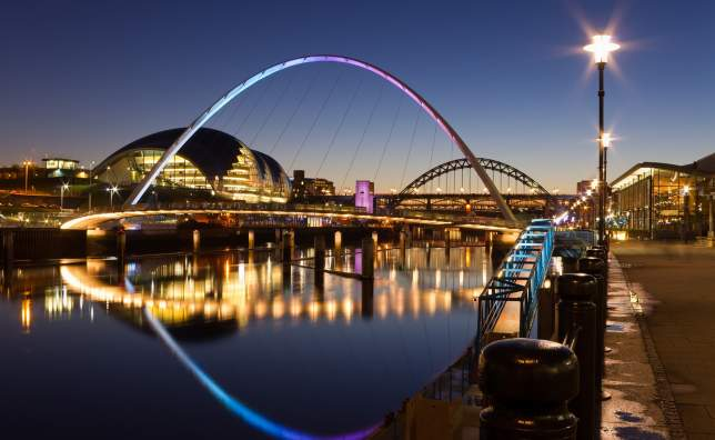 Newcastle quayside at night Newcastles quayside and bridges just after sundown showing the colourful lighting
