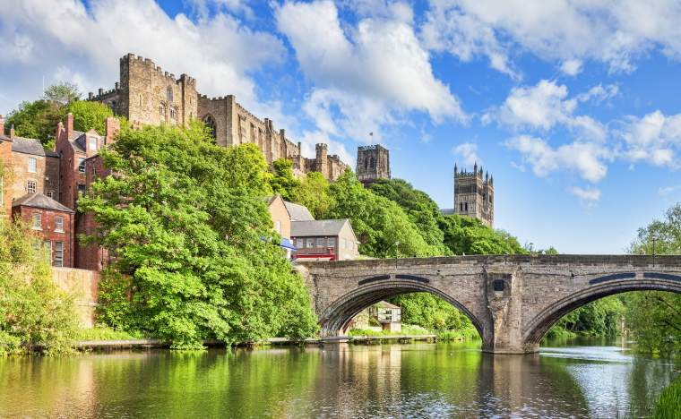 Durham-Castle-and-Cathedral-on-their-rock-above-the-city-and-Framwellgate-Bridge