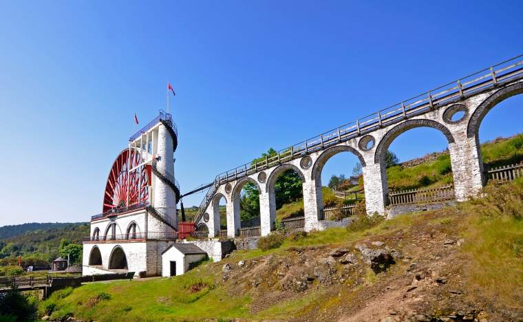 The Great Laxey Wheel with viaduct on sunny day Isle of Man