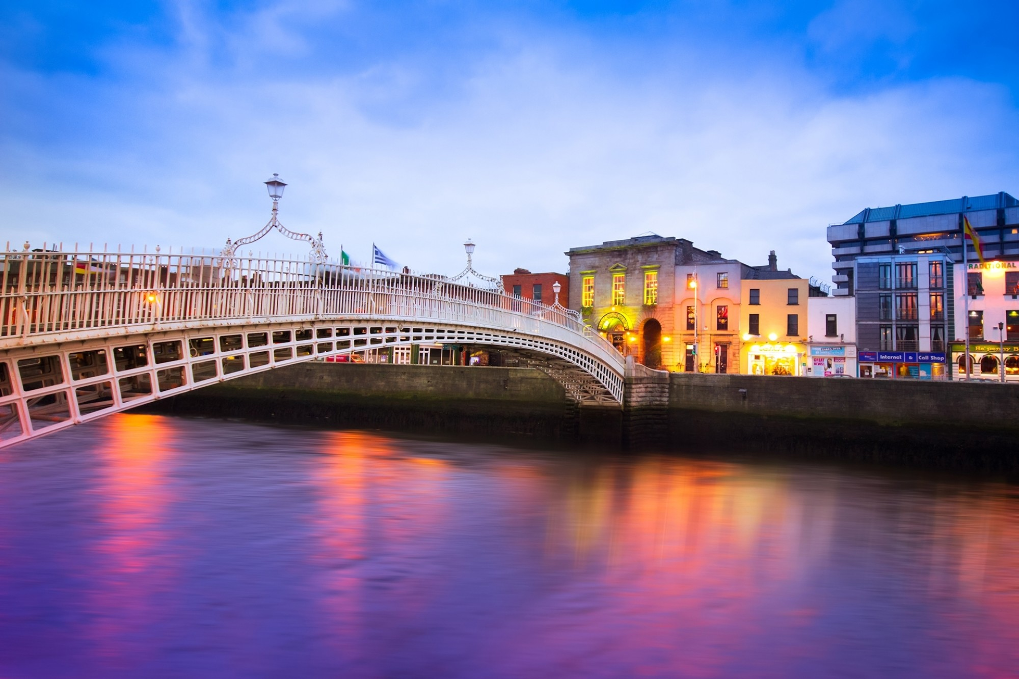 Dublin Ireland at dusk with waterfront and historic Hapenny Bridge